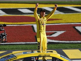 Joey Logano leaps out of his car