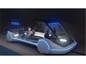 Artist conception of high-occupancy autonomous electric vehicle (AEV) running between exhibit halls