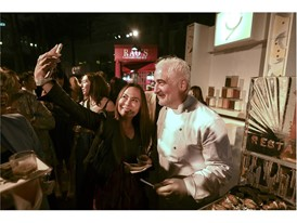A fan takes a selfie with chef Guy Savoy