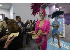 "Showgirls hand out ""passports"" for the IPW 2020 convention"