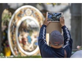A visitor photographs the eight-foot diameter charger