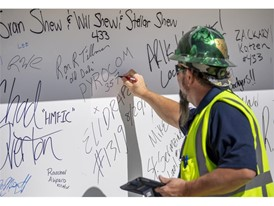 "Workers sign the ""final beam"""