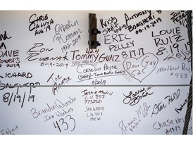 "Signatures decorate the ""final beam"""