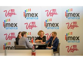 People meet inside the IMEX America Press Center