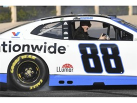 A passenger in Alex Bowman's car