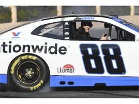 A passenger in Alex Bowman's car