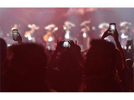 Fans take photos of a mariachi band during a performance by Alejandro Fernández at the Mandalay Bay Events