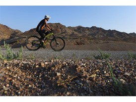 A mountain bike rider makes his way across one of the lower Bootleg Canyon trails