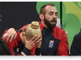 Ashley Cain-Gribble and Timothy Leduc of the United States react