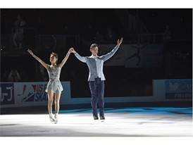 Gold medalist Peng Cheng and Jin Yang of China skate together after winning the pairs competition