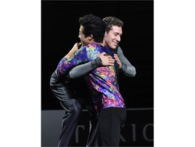 Silver medalist Jason Brown (R) of the United States embraces gold medalist Nathan Chen