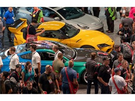 Visitors crowd cars on display