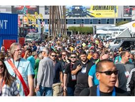 Crowds traverse the exterior displays