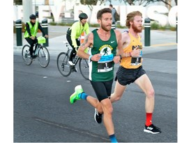 Participants are shown running southbound on the Strip