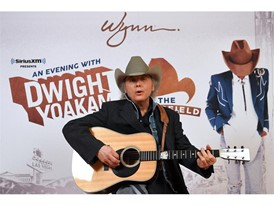 Dwight Yoakam sings