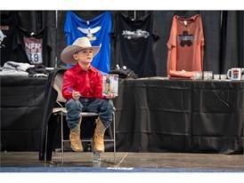 Junior saddle bronc competitor Cayden Burkholder