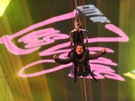 A woman sails along on a zipline