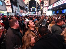 "Revelers celebrate the new year during ""America's Party 2020"" at the Fremont Street Experience"