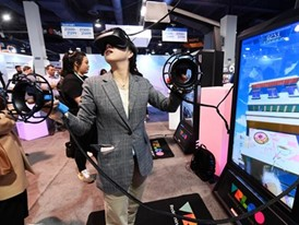 An attendee tries out a virtual reality game