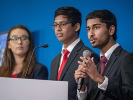 Anish Chejerla, right, with teammates Elizabeth Wigington and Ishaan Raja