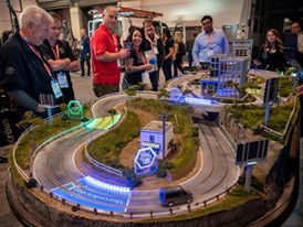 Attendees race Mercedes Pro slot cars