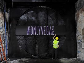 "Ryan Rabbass works on painting the LVCVA's new slogan ""#onlyvegas"" on the wall of a pit that The Boring Company drill"