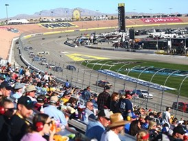 Attendees watch the NASCAR Cup Series Pennzoil 400