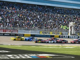Cars race during the NASCAR Cup Series Pennzoil 400