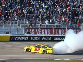 Joey Logano (22) does a burnout
