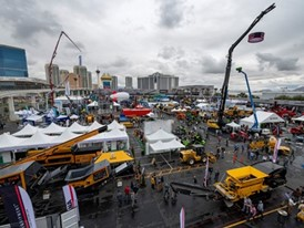 Crowds visit the outdoor exhibitions between rain showers at the ConExpo-Con/Agg show at the Las Vegas Convention Center