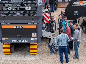Visitors get a tour or the products in the Wirtgen booth, outdoors at the ConExpo-Con/Agg show