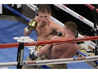 Gennady Golovkin has Canelo Alvarez against the ropes