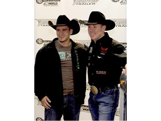 Trevor Brazile (right), record holder for the most World All-Around Cowboy Champion titles, stops by Cowboy Christmas