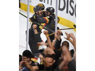 Vegas Golden Knights defenseman Luca Sbisa and Vegas Golden Knights right wing Reilly Smith celebrate
