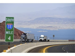 Traffic travels north on Interstate 11 after the grand opening of a new section of the highway
