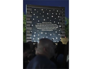 A Shakespeare quote is featured during a memorial event