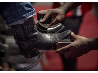 A visitor has his boots shined