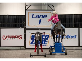 A junior rodeo cowboy practices