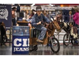 A young rodeo cowboy tries barrel racing