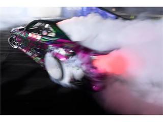A car billows smoke