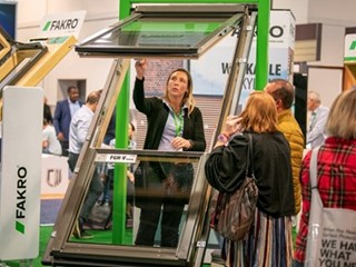In the Fakro booth a representative demonstrates a the way a skylight window opens