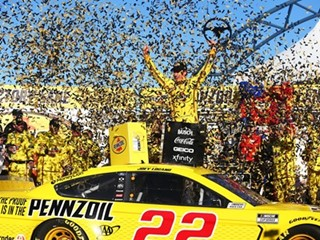 Joey Logano (22) celebrates after winning the NASCAR Cup Series Pennzoil 400