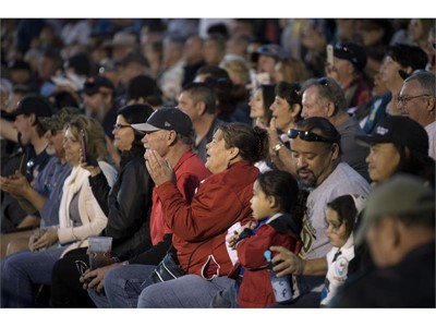 Spectators cheer during the Mesquite Motor Mania car show