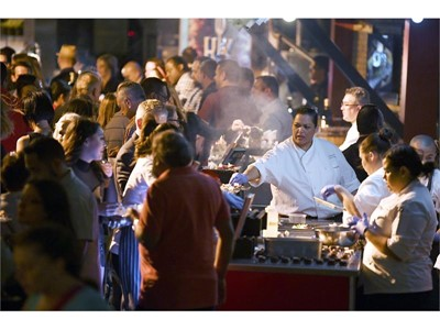 Chefs serve up food during the Grand Tasting at the 12th annual Vegas Uncork'd