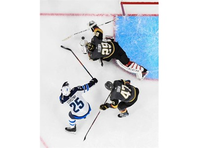 Vegas Golden Knights goaltender Marc-Andre Fleury blocks a shot by Winnipeg Jets