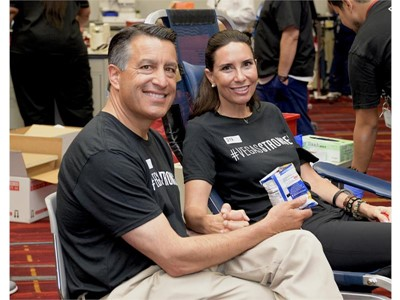 Nevada Governor Brian Sandoval holds a snack for wife Lauralyn as she donates blood