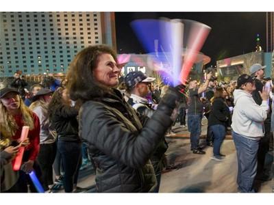 A fan claps her Vegas Golden Knights light sticks