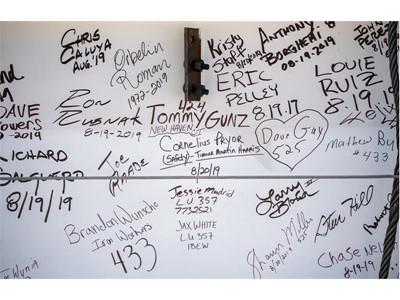 """Signatures decorate the """"final beam"""""""