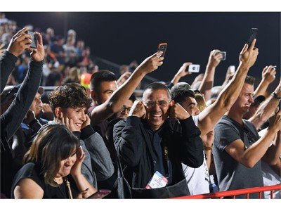 Spectators plug their ears