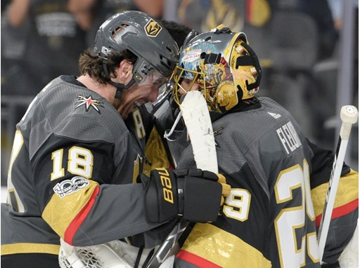 Vegas Golden Knights right wing James Neal (18) congratulates Vegas Golden Knights goalie Marc-Andre Fleury (29)